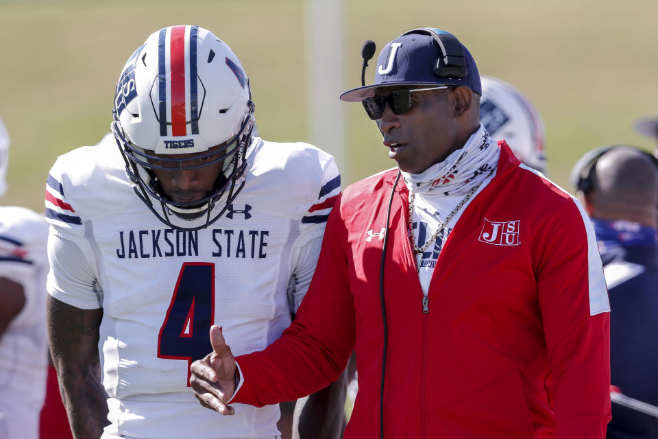 MONTGOMERY, AL - MARCH 20: Head Coach Deion Sanders talk with his quarterback Jalon Jones #4 of the Jackson State Tigers during a time out during the game against the Alabama State Hornets at New ASU Stadium on March 20, 2021 in Montgomery, Alabama. Alabama State Hornets defeated the Jackson State Tigers 35 to 28. (Photo by Don Juan Moore/Getty Images)
