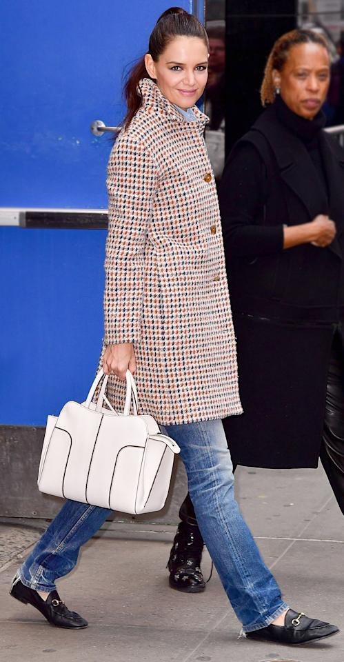 "<p>Collar popped and photo ready, the stylish mom stunned in a navy and burnt sienna checked jacket, faded jeans, and her trusty Gucci loafers ($630; <a rel=""nofollow"" href=""https://click.linksynergy.com/fs-bin/click?id=93xLBvPhAeE&subid=0&offerid=390098.1&type=10&tmpid=8156&RD_PARM1=http%253A%252F%252Fshop.nordstrom.com%252Fs%252Fgucci-brixton-loafer-women%252F4178560%253Fcm_mmc%253DLinkshare-_-partner-_-10-_-1%2526siteId%253DJ84DHJLQkR4-k.AV9hVhBZ0Ytm0llepIBA&u1=ISKatieHolmesSSGucciLoaferIJMarch"">shop.nordstrom.com</a>), pulling it all together with an ivory handbag (shop a similar style <a rel=""nofollow"" href=""https://click.linksynergy.com/fs-bin/click?id=93xLBvPhAeE&subid=0&offerid=365991.1&type=10&tmpid=2174&RD_PARM1=http%3A%2F%2Fwww.&RD_PARM2=saksfifthavenue.com%2Fmain%2FProductDetail.jsp%3F&RD_PARM3=FOLDER%253C%253Efolder_id%3D2534374306622829%2526PRODUCT%253C%253Eprd_id%3D845524447072001%2526R%3D190115476286%2526P_name%3DTod%2527s%2526N%3D4294912299%2B306622829%2526bmUID%3DlIstIjj&u1=ISKatieHolmesSSWhiteBagIJMarch"">here</a>). </p>"