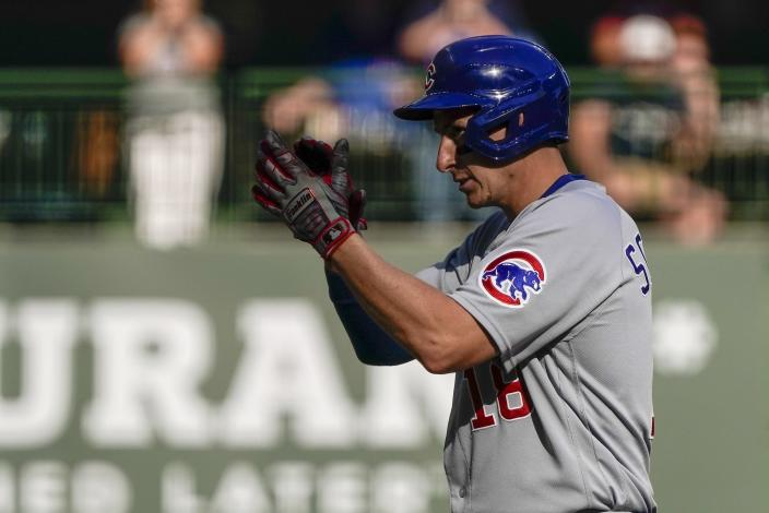 Chicago Cubs' Frank Schwindel reacts after hitting an RBI double during the eighth inning of a baseball game against the Milwaukee Brewers Sunday, Sept. 19, 2021, in Milwaukee. (AP Photo/Morry Gash)