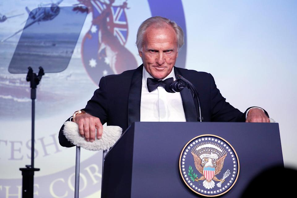 Former golfer Greg Norman of Australia takes up his crutches to leave the stage after delivering remarks at an event commemorating the 75th anniversary of the Battle of the Coral Sea, aboard the USS Intrepid Sea, Air and Space Museum in New York, U.S. May 4, 2017. REUTERS/Jonathan Ernst