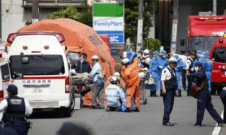 Rescue workers and police officers operate at the site where sixteen people were injured in a suspected stabbing by a man, in Kawasaki, Japan May 28, 2019. in this photo released by Kyodo. Mandatory credit Kyodo/via REUTERS