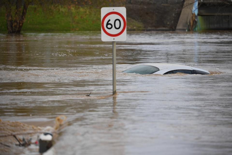 A car is seen submerged by flood water in Traralgon, Victoria, Thursday, June 10, 2021.