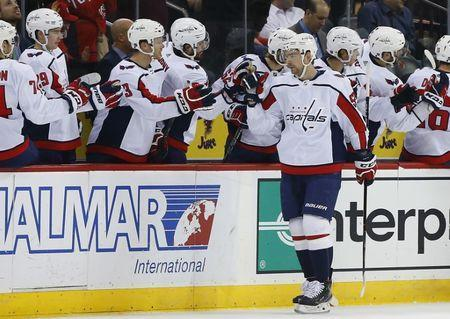 Mar 19, 2019; Newark, NJ, USA; Washington Capitals center Evgeny Kuznetsov (92) celebrates with teammates after scoring a goal against the New Jersey Devils during the second period at Prudential Center. Mandatory Credit: Noah K. Murray-USA TODAY Sports