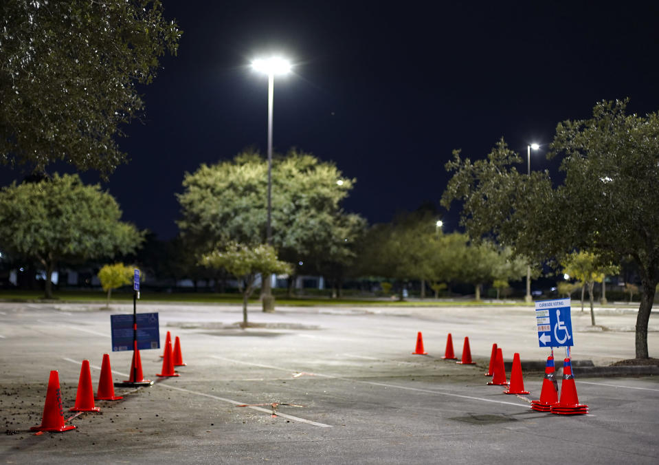 A car-side voting location is empty at Prairie View A&M University Northwest polling station in Houston on Friday, Oct. 30, 2020. The location was one of the eight Harris County's 24-hour locations. ( Elizabeth Conley/Houston Chronicle via AP)