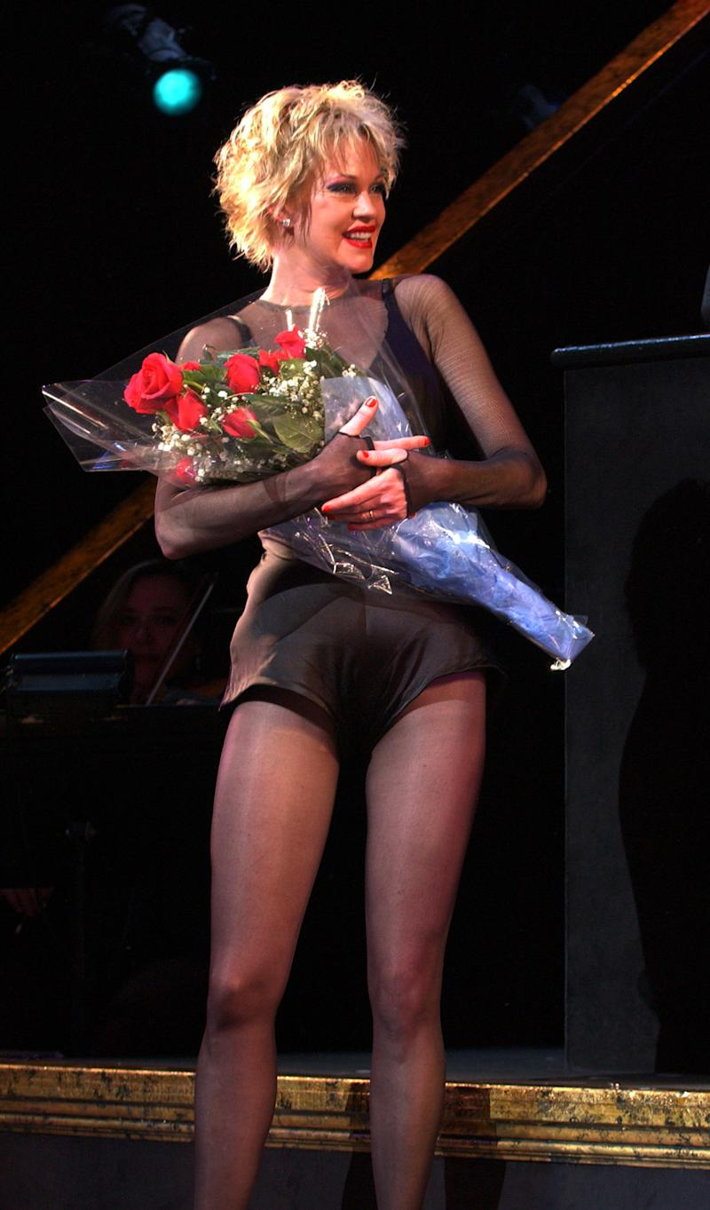 "FILE - In this July 20, 2003 file photo, Melanie Griffith takes a curtain call in the Broadway musical ""Chicago"" at The Ambassador Theatre in New York. Griffith stars as Roxie Hart. The matinee performance on Aug. 27, 2011 will mark the musical's 6,138 show, meaning it vaults over ""A Chorus Line"" to become the fourth longest-running show in Broadway history.  (AP Photo/Louis Lanzano, file)"