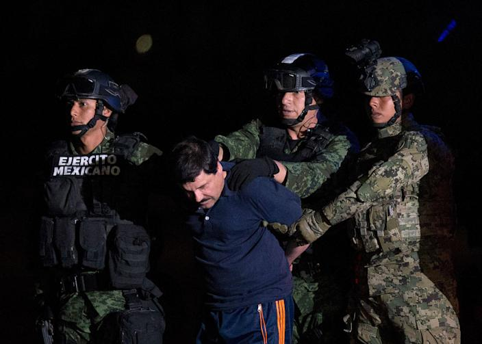 "<p>JAN. 8, 2016 — Mexican drug lord Joaquin ""El Chapo"" Guzman is escorted by army soldiers to a waiting helicopter, at a federal hangar in Mexico City. (Rebecca Blackwell/AP) </p>"