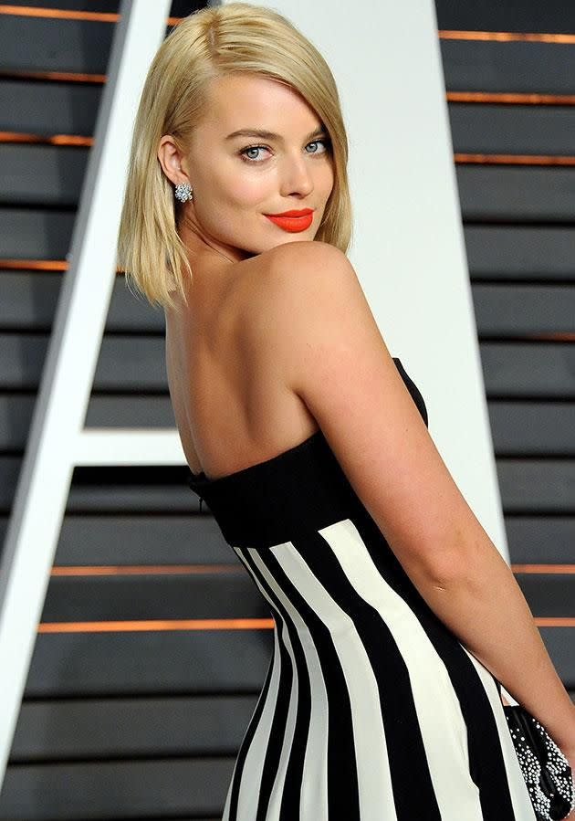 This is how Margot Robbie skips having to wear lipstick. Photo: Getty.