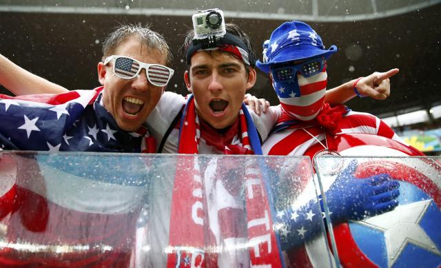 U.S. fans pose for the camera before the 2014 World Cup Group G soccer match between the U.S. and Germany at the Pernambuco arena in Recife June 26, 2014. The fan in the centre wears a GoPro on his forehead. Shares of GoPro Inc, a maker of cameras used by surfers, skydivers and other action junkies to record and post their exploits online, rose as much as 38 percent in their market debut.The company's shares rose to a high of $33 in early Nasdaq trading on Thursday, valuing the company that popularized action cameras for consumers at about $4 billion. REUTERS/Tony Gentile (BRAZIL - Tags: SOCCER SPORT SCIENCE TECHNOLOGY WORLD CUP)