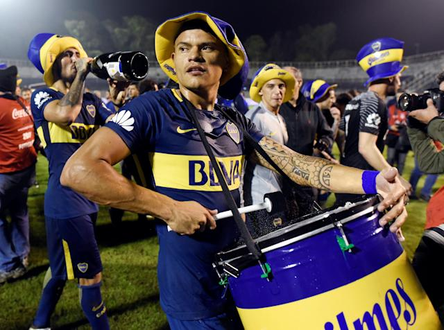 Soccer Football - Boca Juniors v Gimnasia y Esgrima La Plata - Argentine Superliga - Juan Carmelo Zerillo stadium, La Plata, Argentina - May 9, 2018 - Boca Juniors' player Walter Bou beats a drum as he celebrates after clinching the Argentine Superliga championship at the end of their match against Gimnasia y Esgrima La Plata. REUTERS/Stringer