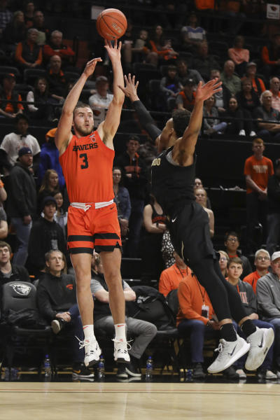 Oregon State's Tres Tinkle (3) shoots over Colorado's Shane Gatling during the first half of an NCAA college basketball game in Corvallis, Ore., Saturday, Feb. 15, 2020. (AP Photo/Amanda Loman)
