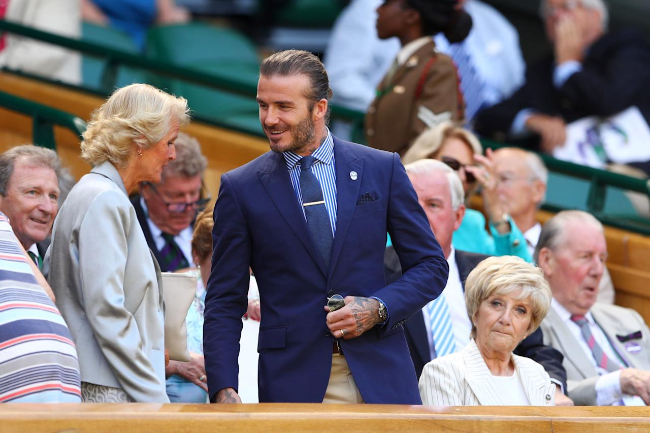 "<p>Doing a nice thing and taking his mum to the Royal Box for the day (bottom right, give us a wave Sandra), <a rel=""nofollow"" href=""http://www.esquire.co.uk/style/fashion/news/g9775/20-times-david-beckham-showed-you-the-key-to-modern-mens-style/"">David Beckham</a> never fails to impress when he's out at the All England Club. As shown by this solid take on 'smart preppy' - Polo Ralph Lauren, of course - with a dash of man bun and hand tat' thrown in. </p>"