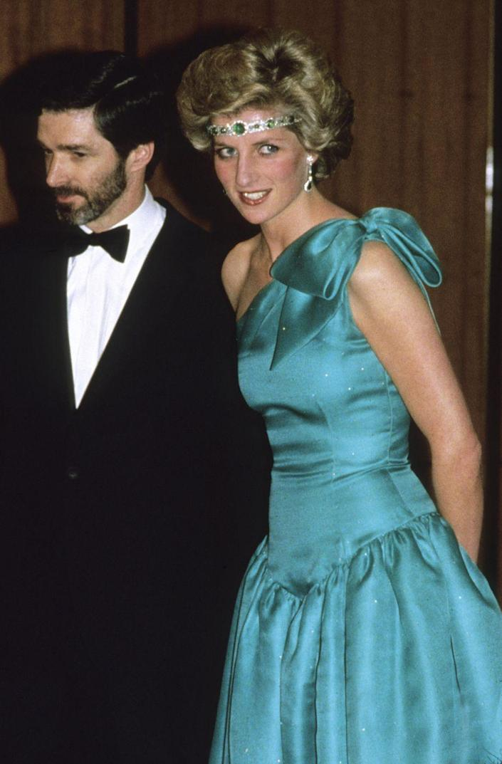 """<p>Princess Diana was a fashion risktaker. When she was loaned a diamond and emerald Garrard choker by the Queen (<a href=""""https://www.telegraph.co.uk/luxury/jewellery/inside-princess-dianas-jewellery-collection/princess-diana-wearing-art-deco-emerald-diamond-choker-tate/"""" rel=""""nofollow noopener"""" target=""""_blank"""" data-ylk=""""slk:originally commissioned by Queen Mary in the 1920s"""" class=""""link rapid-noclick-resp"""">originally commissioned by Queen Mary in the 1920s</a>), she turned it into a headband. The royal wowed fans at the gala she was attending in Melbourne, Australia, but we have to wonder what the Queen thought...</p>"""