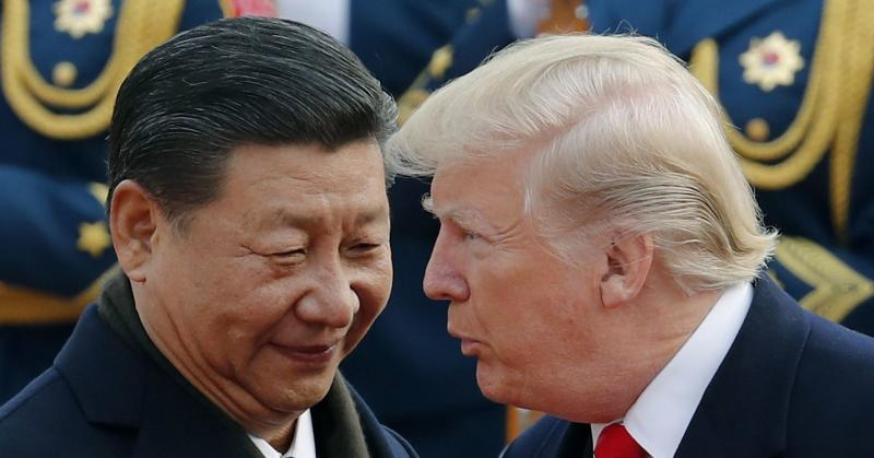 Chinese President Xi Jinping chats with President Donald Trump during a welcome ceremony in Beijing on Nov. 9, 2017.