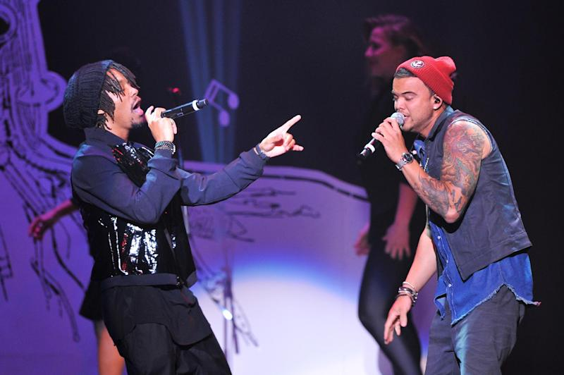 "Singers Lupe Fiasco, left, and Guy Sebastian perform at ""Play It Forward: A Celebration of Music's Evolution and Influencers"" at the Grammy Foundation's 15th Annual Music Preservation Project, Thursday, Feb. 7, 2013, in Los Angeles. (Photo by Vince Bucci/Invision/AP)"