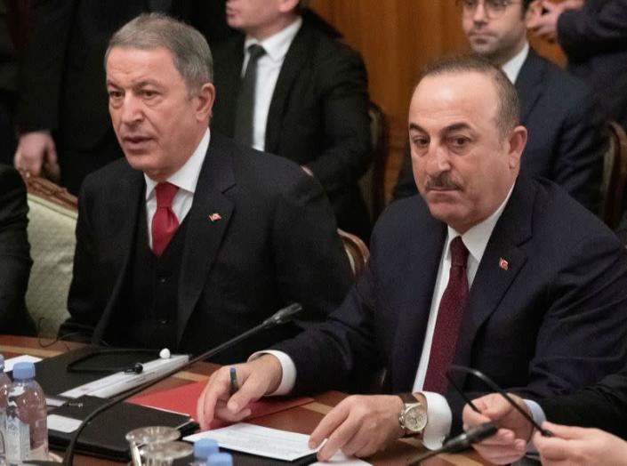 FILE PHOTO: Turkish Foreign Minister Mevlut Cavusoglu and Defence Minister Hulusi Akar attend a meeting with Russian Foreign Minister Sergei Lavrov and Defence Minister Sergei Shoigu in Moscow