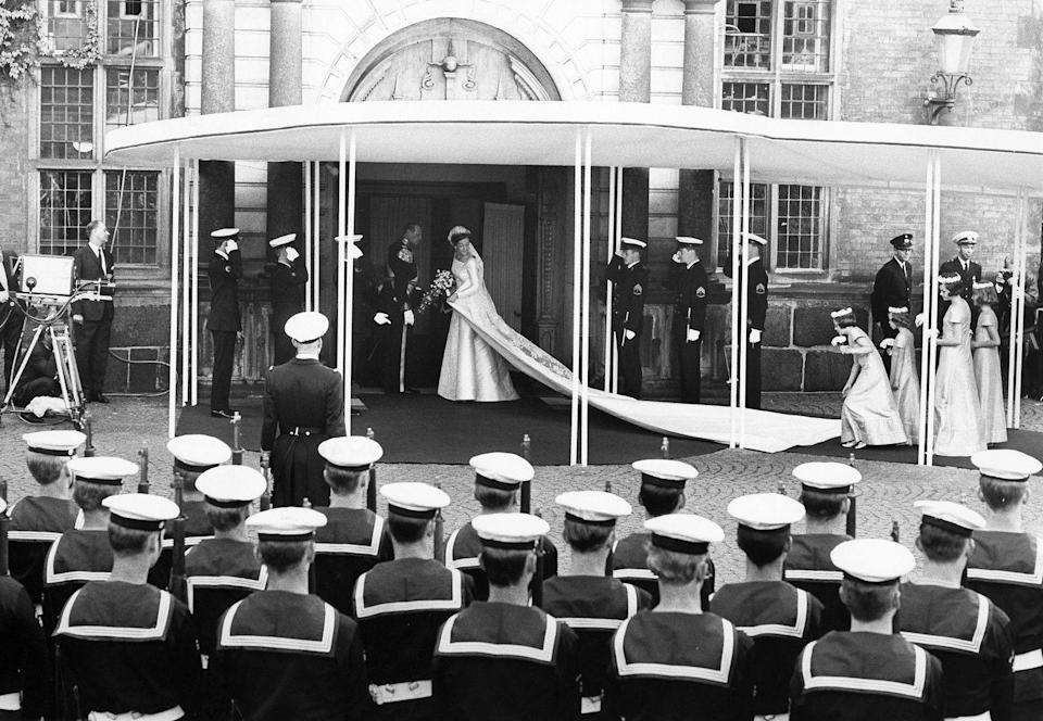 <p>Like her sister (Princess Anne Marie), the reigning Queen of Denmark opted for a gown by Jørgen Bender. The silk dress featured a square neckline and a lengthy train. </p>