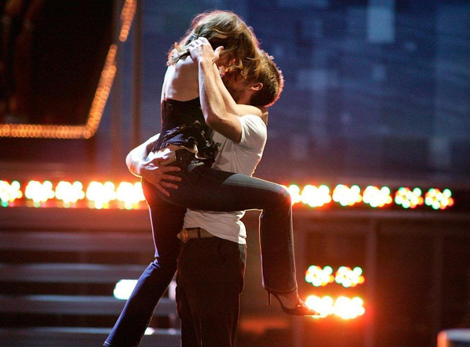 <p>For The Notebook, of course. The kissing-in-the-rain moment from the film was recreated by the then couple with a run up, jump and long kiss perfectly choreographed to Maroon 5's 'She Will Be Loved'.</p>