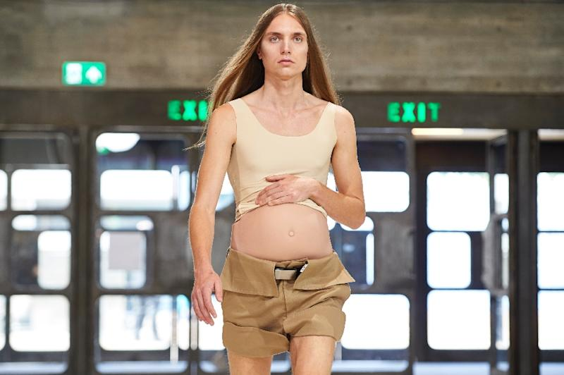 Chinese designer Xander Zhou's new collection featured a fake 'baby bump' for men (AFP Photo/NIKLAS HALLE'N)