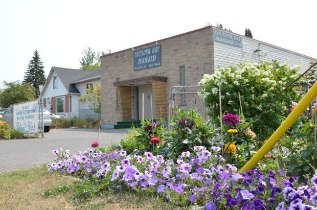 A carefully cultivated garden grows in front of the masjid in Thunder Bay, Ont. The beauty it offers, the local imam says, is just the simplest of ways Muslim people in the city work toward betterment of the community. (Logan Turner/CBC - image credit)