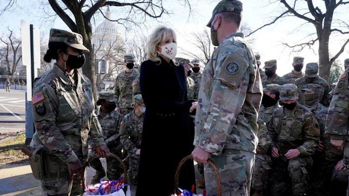 U.S. first lady Jill Biden surprises National Guard members outside the Capitol with chocolate chip cookies