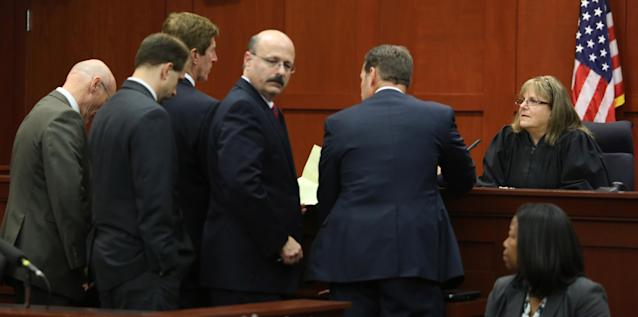 SANFORD, FL - JULY 13: Judge Debra Nelson (R) confers with attorneys after informing them that the jury had a question on instructions for a charge of manslaughter, on the 25th day of George Zimmerman's trial at the Seminole County Criminal Justice Center July 13, 2013 in Sanford, Florida. Zimmerman is charged with second-degree murder in the 2012 shooting death of Trayvon Martin. (Photo by Joe Burbank-Pool/Getty Images)