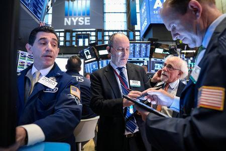 Traders work on the floor at the New York Stock Exchange (NYSE) in New York, U.S., April 9, 2019. REUTERS/Brendan McDermid