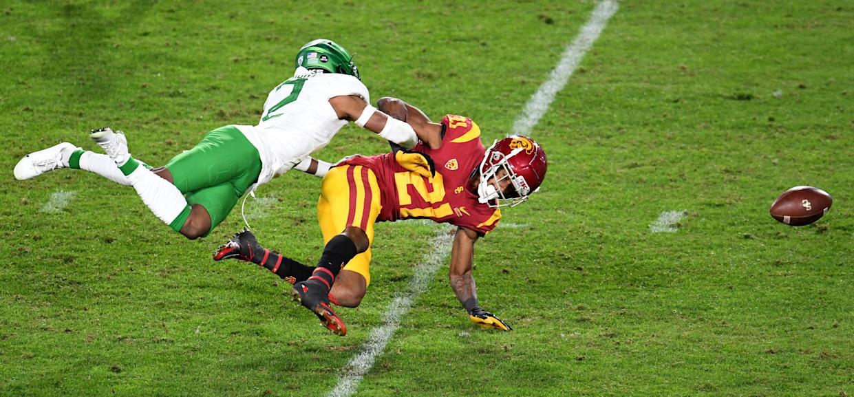 Los Angeles, CA - December 18:  Cornerback Mykael Wright #2 of the Oregon Ducks knocks away a pass intended for wide receiver Tyler Vaughns #21 of the USC Trojans in the third quarter of the PAC 12 Championship football game at the Los Angeles Memorial Coliseum on Friday, December 18, 2020 in Los Angeles on Friday, December 18, 2020. (Photo by Keith Birmingham/MediaNews Group/Pasadena Star-News via Getty Images)