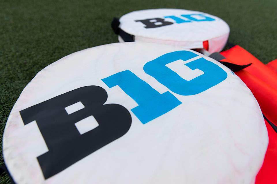 Big Ten logo on yardage markers during warmups prior to a Wisconsin game at Camp Randall Stadium.