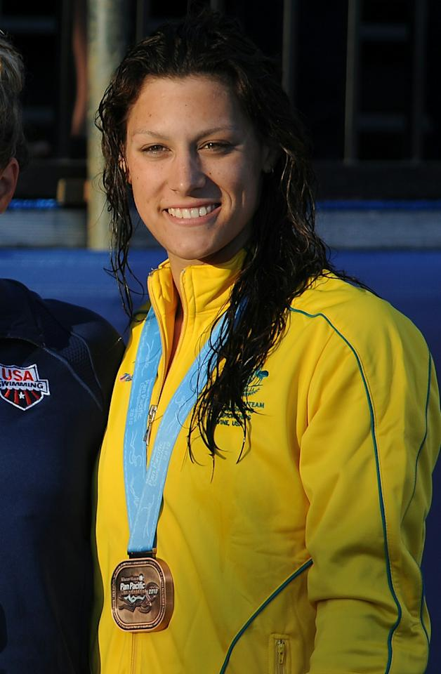 """(FILES) In this  August 21, 2010 photograph, bronze medal winner Blair Evans of Australia pose on the podium of the women's 400m freestyle final at the Pan Pacific Swimming Championships in Irvine, California. Five of the eight gold medals up for grabs on October 4, 2010, the first day of competition at the 2010 New Delhi Commonwealth Games, are in swimming.  Challengers from the British """"home nations"""" include Scotland's Hannah Miley and Jaz Carlin from Wales, while England's Rebecka Adlington could be pushed by the talented Australian trio of Blair Evans, Bronte Barratt and Kylie Palmer.   AFP PHOTO / ROBYN BECK / FILES (Photo credit should read ROBYN BECK/AFP/Getty Images)"""