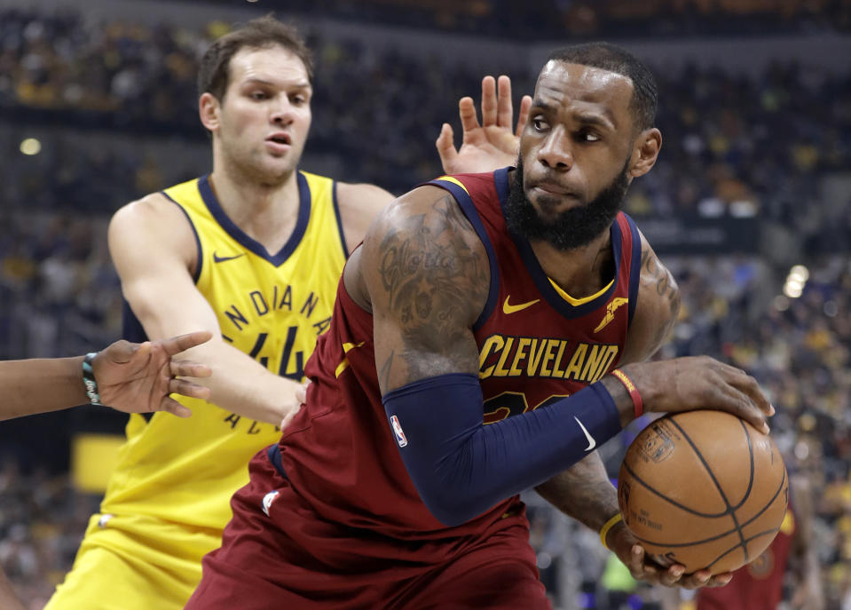 LeBron James, right, looks to pass as the Pacers' Bojan Bogdanovic defends him during the first half Sunday. (AP)