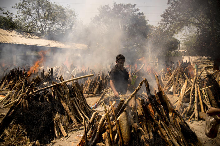 Image: Funeral pyres in New Delhi this week (Anindito Mukherjee / Getty Images)