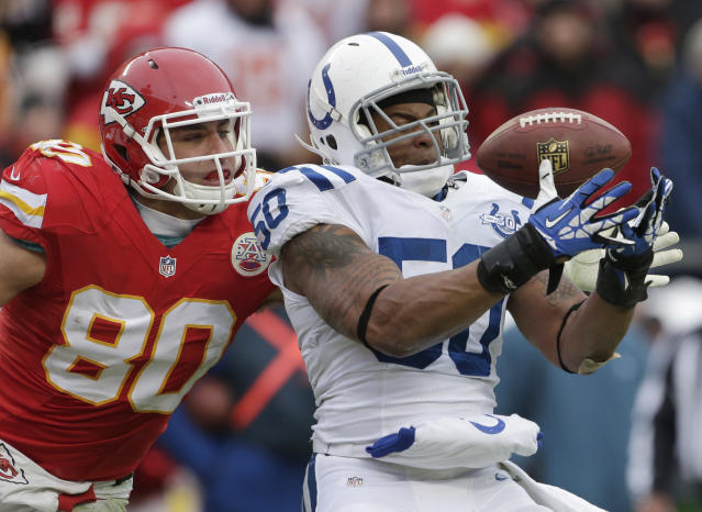Indianapolis Colts inside linebacker Jerrell Freeman (50) intercepts a pass intended for Kansas City Chiefs tight end Anthony Fasano (80) during the second half of an NFL football game at Arrowhead Stadium in Kansas City, Mo., Sunday, Dec. 22, 2013. (AP Photo/Charlie Riedel)