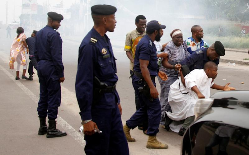 Riot policemen fire tear gas to disperse Catholic priest and demonstrators during a protest against President Joseph Kabila, organized by the Catholic church in Kinshasa, Democratic Republic of Congo January 21, 2018. REUTERS/Kenny Katombe