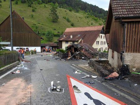 Parts of one of two planes which crashed during an air show are seen in the village of Dittingen, Switzerland in this handout photo provided by Kantonspolizei Basel Landschaft on August 23, 2015. REUTERS/Kantonspolizei Basel Landschaft/Handout via Reuters