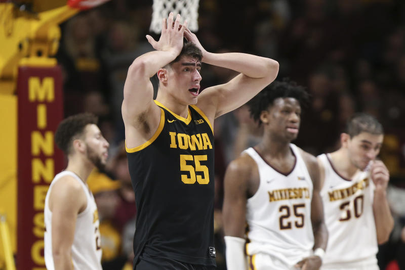 Iowa's Luka Garza (55) reacts after fouling out of an NCAA college basketball game against Minnesota, Sunday, Feb. 16, 2020, in Minneapolis. (AP Photo/Stacy Bengs)