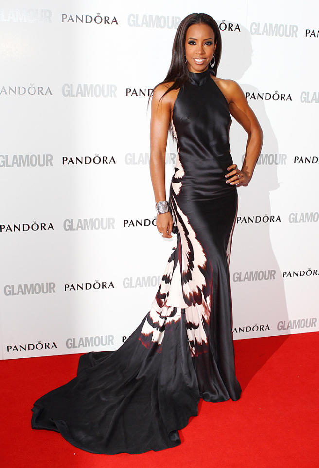 Following in Lea's footsteps was former Destiny's Child member, Kelly Rowland, who looked better than ever at the star-studded soiree in a Maria Grachvogel halterneck gown, which featured a lengthy train and an equally dramatic pattern on the back. What do you make of Ms. Rowland's frock? Hot or not? (5/29/2012)