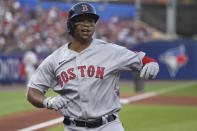 Boston Red Sox's Rafael Devers celebrates his home run during the fourth inning of the team's baseball game against the Toronto Blue Jays on Wednesday, July 21, 2021, in Buffalo, N.Y. (AP Photo/Joshua Bessex)