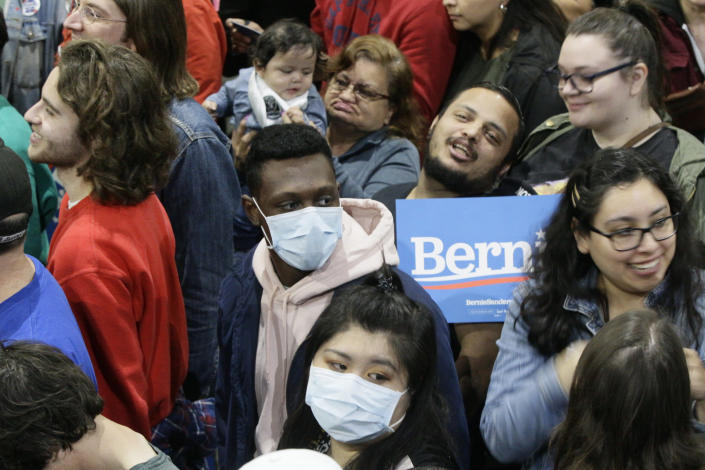 Supporters wearing face masks at a Sanders campaign event in Los Angeles on Sunday. (Damian Dovarganes/AP)