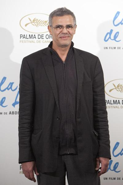 """FILE - In this Oct. 22, 2013 file photo, Director Abdellatif Kechiche attends """"La Vida De Adele"""" (Blue Is The Warmest Color) photocall at the Santo Mauro Hotel in Madrid, Spain. Four of the five directors of Golden Globe-nominated foreign-language films, Paolo Sorrentino, """"A Great Beauty,"""" Kechiche, """"Blue Is the Warmest Color,"""" Thomas Vinterberg, """"The Hunt,"""" and Asghar Farhadi, """"The Past,"""" gather in Hollywood for a panel symposium on their films nominated for Best Foreign Language Film at The Egyptian Theatre on Saturday, Jan. 11, 2014. Hayao Miyazaki, whose film, """"The Wind Rises"""" is also nominated in the same category, is unable to attend. (AP Photo/Abraham Caro Marin, File)"""