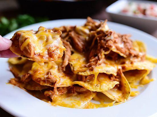 """<p>Refried beans and nachos were practically made for each other. Dollop some beans on your chips before adding cheese and other toppings—you can't go wrong!</p><p><a href=""""https://www.thepioneerwoman.com/food-cooking/recipes/a11968/chicken-nachos/"""" rel=""""nofollow noopener"""" target=""""_blank"""" data-ylk=""""slk:Get Ree's recipe."""" class=""""link rapid-noclick-resp""""><strong>Get Ree's recipe. </strong></a></p>"""