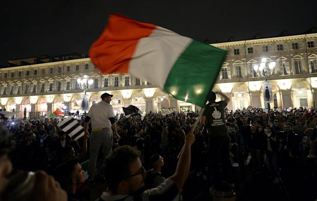 Soccer Football - Serie A - AS Roma vs Juventus - Turin, Italy - May 13, 2018 Juventus' supporters celebrate in downtown Turin after winning the league. REUTERS/Massimo Pinca