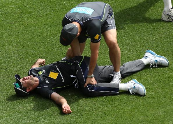 BRISBANE, AUSTRALIA - NOVEMBER 07:  Physiotherapist Alex Kountouris stretches Ricky Ponting during an Australian nets session at The Gabba on November 7, 2012 in Brisbane, Australia.  (Photo by Chris Hyde/Getty Images)