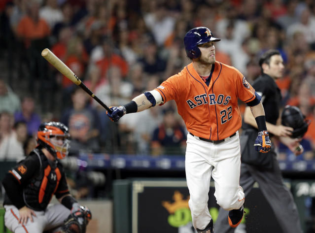Houston Astros' Josh Reddick watches his home run during the fifth inning of the team's baseball game against the Baltimore Orioles on Friday, June 7, 2019, in Houston. (AP Photo/Michael Wyke)