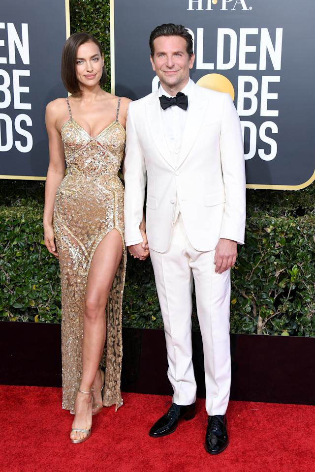 <p>Irina Shayk and Bradley Cooper made a rare red carpet appearance together at the Globes. The stunning model wore a glittering gold dress and Best Actor nominee Bradley wowed in an all-white suit. Photo: Getty Images </p>