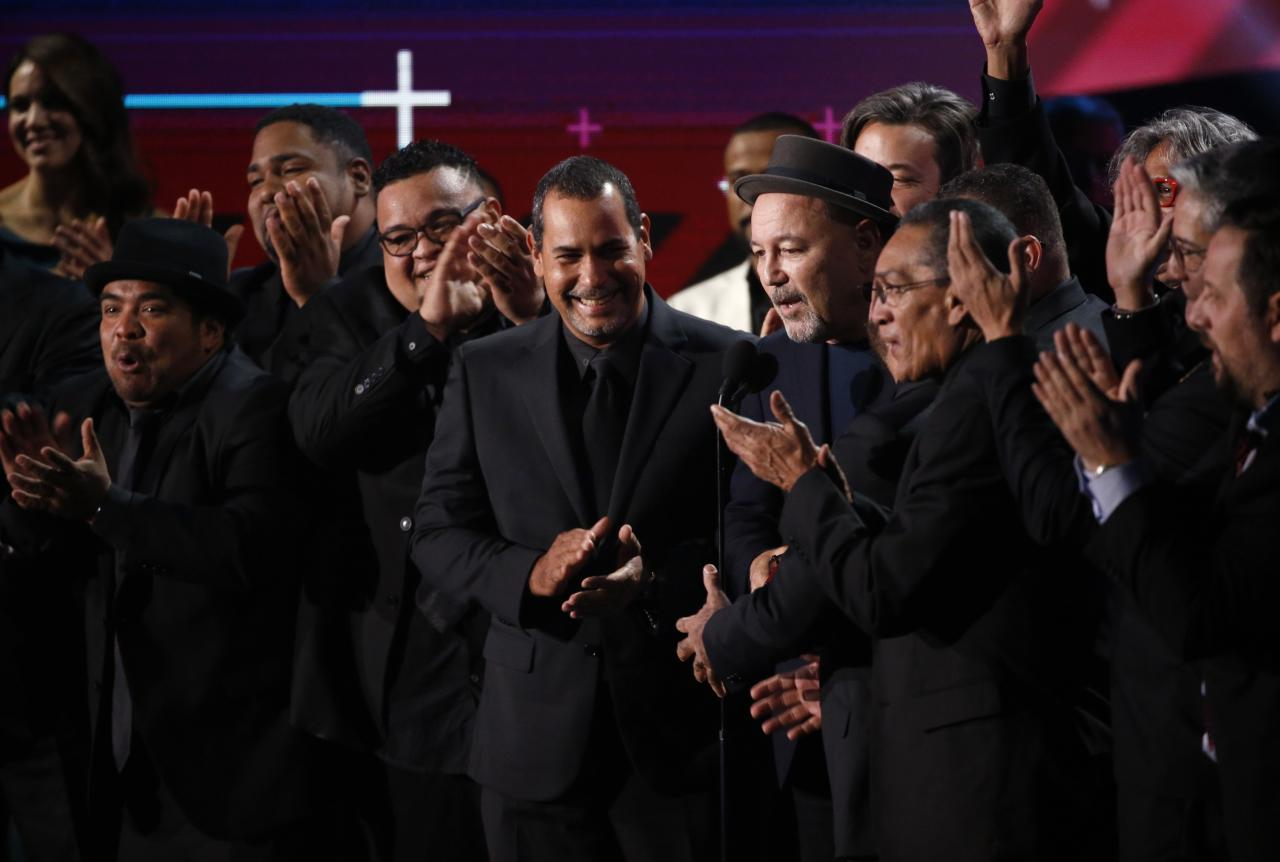 "18th Latin Grammy Awards – Show – Las Vegas, Nevada, U.S., 16/11/2017 – Ruben Blades  (wearing hat) accepts the Album of the Year award for ""Salsa Big Band."" REUTERS/Mario Anzuoni"