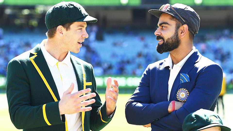 Indian captain Virat Kohli (pictured right) before the toss with Tim Paine (pictured left).