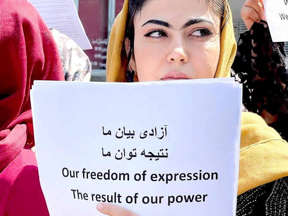 Women gather to demand their rights under the Taliban rule during a protest in Kabul (Reuters)