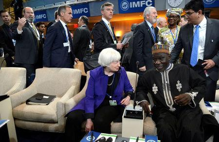 U.S. Federal Reserve Board Chairperson Janet Yellen chats with Cameroon's Finance Minister Alamine Ousmane Mey before the start of the International Monetary and Financial Committee (IMFC) meeting, as part of the IMF and World Bank's 2017 Annual Spring Meetings, in Washington, U.S., April 22, 2017.   REUTERS/Mike Theiler