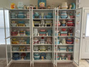 """This image provided by Megan Telfer shows the wide selection of antique Pyrex dishes she displays at her Texas home. Telfer has more than 300 pieces of vintage Pyrex, displayed on three large bookcases. Telfer's 5-year-old daughter has some vintage Pyrex, too. """"We don't use 90 percent of it,"""" Telfer said. """"I display it."""" (Megan Telfer via AP)"""
