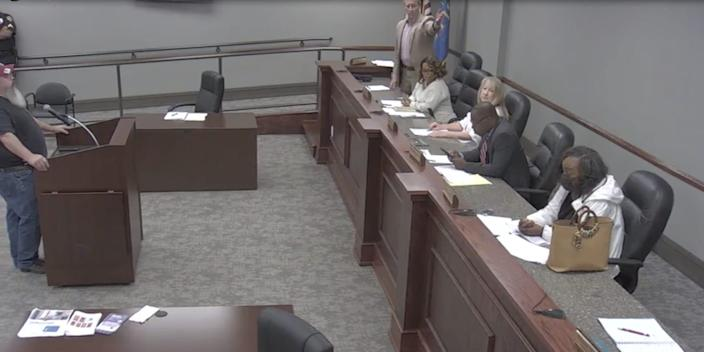 A still from a Tarrant City Council meeting showing councilman Tommy Bryant appearing to indicate Black colleague Veronica Freeman.